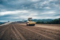 Детали строительной площадки шоссе - работая тандемное машинное оборудование вибрации Стоковая Фотография