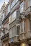Деталь балконов и больших окон на времени ninetee Стоковое фото RF