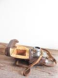 Деталь винтажной камеры фильма на деревянной предпосылке Стоковые Изображения RF