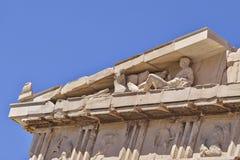 Деталь виска древнегреческия, человек кладя вниз с статуи Стоковые Изображения
