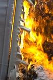 Деталь горения пластмасового контейнера и расплавленная огнем Стоковое Изображение