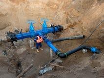 Деталь запорных заслонок штуцеров, 250mm и 150mm, членов уменьшения совместных в системе водообеспечения питья Стоковое фото RF