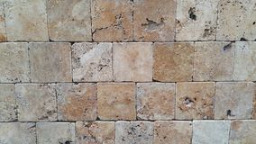 Деталь конца-вверх старой выдержанной кирпичной стены Стоковые Фото