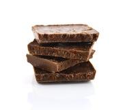 Деталь крупного плана шоколада разделяет на белой предпосылке Стоковое фото RF
