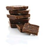 Деталь крупного плана шоколада разделяет на белой предпосылке Стоковые Фото
