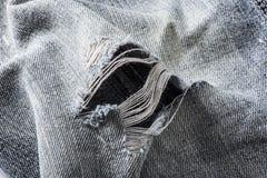 Деталь отверстия в голубых джинсах Стоковая Фотография