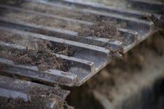 Деталь пакостной проступи землекопа или бульдозера Стоковые Изображения