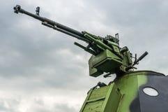 Деталь трубки карамболя (пулемета) и armored военного транспортного средства Стоковая Фотография RF