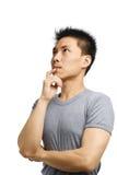 детеныши азиатского человека думая Стоковая Фотография RF