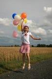 детеныши девушки воздушного шара стоковая фотография