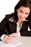 детеныши документа коммерсантки подписывая Стоковое фото RF
