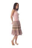 детеныши женщины верхней части бака юбки стоковое фото