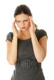 детеныши женщины головной боли дела Стоковая Фотография
