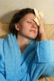 детеныши женщины головной боли Стоковое Изображение