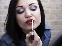 детеныши женщины губной помады Стоковое Изображение
