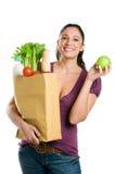 детеныши женщины зеленой бакалеи мешка яблока Стоковое Фото