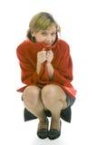 детеныши женщины милой куртки красные стоковое изображение