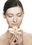детеныши женщины орхидеи Стоковые Изображения