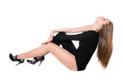 детеныши женщины подходящего костюма черного тела плотные стоковая фотография rf