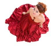 детеныши женщины привлекательного платья красные сидя Стоковые Фото