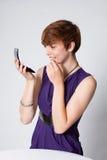 детеныши женщины состава платья пурпуровые кладя Стоковое Изображение RF