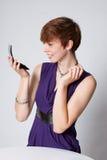 детеныши женщины состава платья пурпуровые кладя Стоковое фото RF