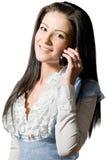 детеныши женщины сотового телефона говоря Стоковое фото RF