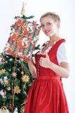 детеныши женщины costume рождества традиционные стоковые фото