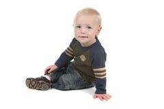 детеныши косого усаживания ребёнка сладостные стоковое изображение