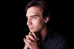детеныши красивого портрета человека думая Стоковое фото RF