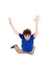 детеныши мальчика скача Стоковое фото RF