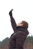 детеныши мобильного телефона человека Стоковое Изображение RF