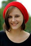 детеныши портрета девушки крышки красные Стоковое Изображение RF