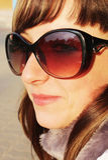 детеныши солнца портрета стекел девушки Стоковое Изображение
