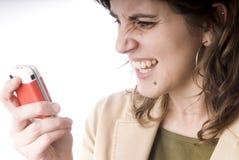 детеныши телефона девушки Стоковая Фотография RF