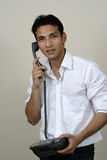 детеныши телефона человека Стоковое Изображение