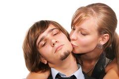 детеныши человека девушки целуя Стоковые Фото