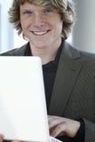 детеныши человека компьтер-книжки Стоковая Фотография RF