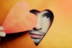 детеныши человека сердца peering Стоковое Изображение