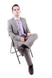 детеныши человека стула дела сидя стоковое изображение