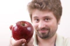 детеныши человека яблока Стоковая Фотография
