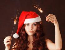детеныши santa шлема девушки claus Стоковая Фотография