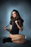 Детеныши slim повелительница очарования одетьнная в черноте Стоковое фото RF