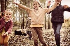 Дети бежать совместно в парке Стоковая Фотография