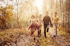 Дети бежать совместно в парке Стоковое фото RF