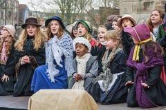 Дети выполняют в мюзикл во время фестиваля Dickens Стоковая Фотография RF