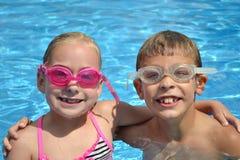 Дети в бассейне Стоковые Фото