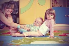 Дети в питомнике Стоковые Фотографии RF