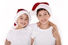 Дети в шляпе Санта Клауса Стоковые Фото