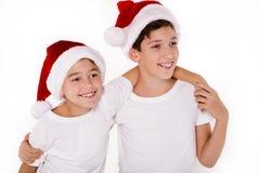 Дети в шляпе Санта Клауса Стоковые Фотографии RF